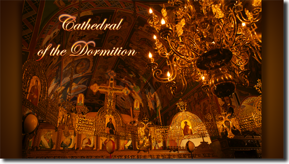 The apse above the sanctuary, iconastasis, oros and chandelier, at   night.