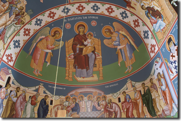 The Platytera. The Theotokos of Sign, with Archangels Micheal and Gabriel, in   the apse above the sanctuary. The icon of the Communion of the Apostles is below.